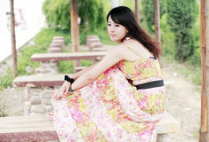 Young Asian girl relaxing. Outdoor Stock Photo