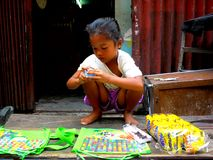 Young Asian girl selling candies in quiapo, manila, philippines in asia Royalty Free Stock Images
