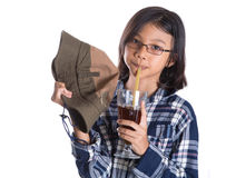 Young Asian Girl With Shirt, Hat and Drink III Royalty Free Stock Images