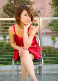 Young Asian Girl Sit Outdoor Looking To Side Royalty Free Stock Images