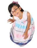 Young Asian Girl Sitting Down Laughing III Royalty Free Stock Photos