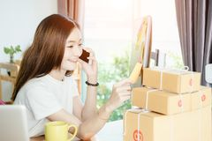 Young asian girl is smiling with her private business Stock Images