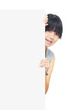 Young asian girl standing behind a blank board Stock Photos