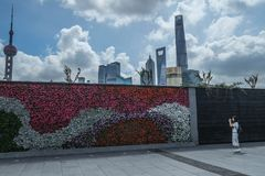 Young Asian tourist taking photo of Shanghai skyline Stock Photos