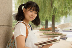 Young Asian girl studying hard  in the park Stock Photos