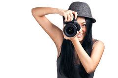 Young asian girl taking a photo. A pretty asian girl taking photos with an SLR camera and smiling Stock Photography