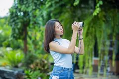 Young asian girl taking  photo in the garden Stock Photography