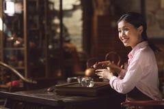 Young asian girl at tea ceremony Stock Photos