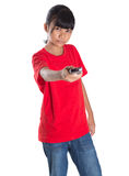 Young Asian Girl With TV Remote II Royalty Free Stock Images