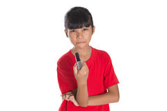 Young Asian Girl With TV Remote III Stock Photos