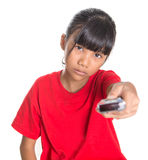Young Asian Girl With TV Remote VI Stock Photo