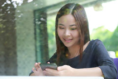 Young Asian girl use tablet for search information Royalty Free Stock Photos