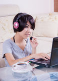 Young asian girl using laptop Stock Images