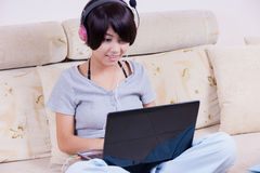 Young asian girl using laptop Stock Photo
