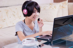 Young asian girl using laptop Royalty Free Stock Photo