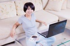 Young asian girl using laptop Stock Photo