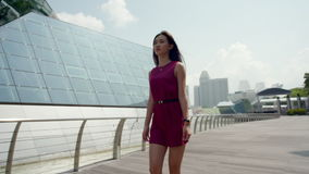 Young asian girl walking confidently outdoor in slow motion stock video footage