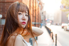 Young Asian girl walking in the street of Shanghai Stock Images