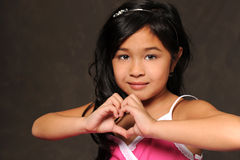 Young Asian Girls Making Heart with Hands Stock Image