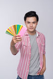 Young asian graphic designer holding color palette Stock Image