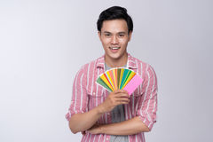 Young asian graphic designer holding color palette.  royalty free stock photo