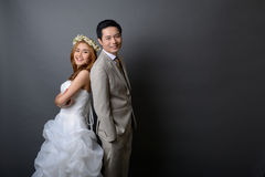 Young asian groom and bride posing and smiling in studio for pre Stock Photography