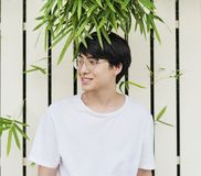 Young asian guy wearing glasses portrait stock photo