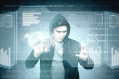 Young asian hacker in black hoodie touching virtual screen. With server data, binary code, bar graph and world map background stock image
