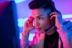 Young Asian cyber sport gamer royalty free stock photo