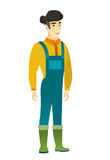 Young asian happy farmer in coveralls. Royalty Free Stock Photography