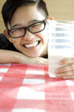 Young asian holding glass of milk Stock Photography