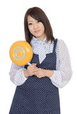 Young asian housewife with frying pan Stock Images