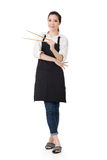Young Asian housewife hold a chopsticks Stock Photography