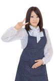 Young asian housewife showing the peace sign Stock Images