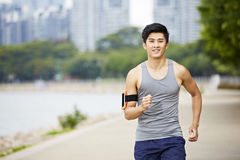 Young asian jogger running in park Stock Image