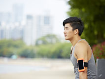 Young asian jogger taking a break royalty free stock image