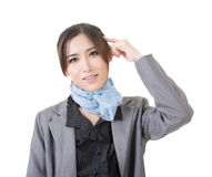 Young Asian lady put finger on head Royalty Free Stock Photography
