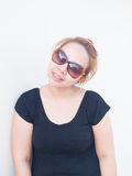 Young Asian lady wearing sunglasses smiling in nature Royalty Free Stock Images