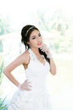 Young Asian lady in white bride dress Royalty Free Stock Photo