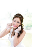 Young Asian lady in white bride dress Royalty Free Stock Images