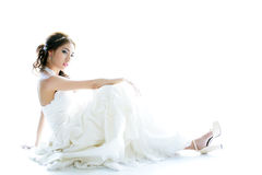 Young Asian lady in white bride dress Royalty Free Stock Photos