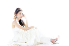 Young Asian lady in white bride dress Stock Photos