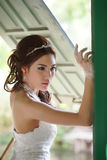 Young Asian lady in white bride dress Stock Image