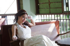 Young Asian lady in white bride dress Stock Photo
