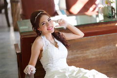 Young Asian lady in white bride dress Stock Photography