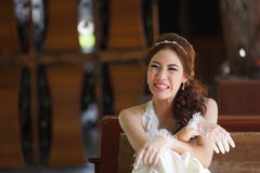 Young Asian lady in white bride dress Royalty Free Stock Image