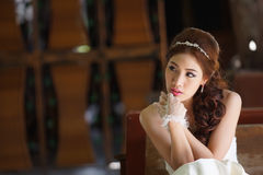 Young Asian lady in white bride dress Stock Images