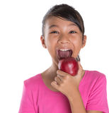 Young Asian Malay Teenager Eating Red Apple V Royalty Free Stock Images