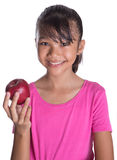 Young Asian Malay Teenager Eating Red Apple VIII Royalty Free Stock Images