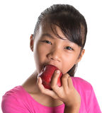 Young Asian Malay Teenager Eating Red Apple X Stock Images